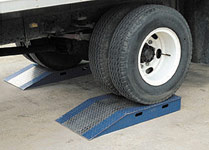 "10"" High Aluminum Wheel Risers (Pair) - 30,000lb Capacity. The other end, called the break over because it flattens out approximately 11 inches back from the end of the board, goes into the truck.  At the point where it becomes horizontal, fork trucks have a smooth transition over an even grade which is more stable for transit and safe for personnel."