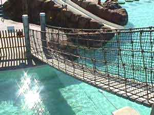 Safety netting in the amusement netting takes many forms.  Often, it is made from UV and chemically resistant rope to make it more durable in outdoor and aquatic environments.
