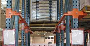 A drive thru pallet rack system involves placing the pallets in a large solid area.  Instead of having fork lift runs between the racks of shelving, they are placed up against each other, and are then removed one at a time as required.