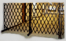 Steel Portable Folding Gates. Schools have to be on guard against theft and vandalism.  They commonly use portable security gates both inside the building and outside the building to restrict access to the building.
