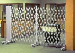 The classic folding gate design is that of an interlocking lattice of steel, riveted back to back to provide a sturdy barrier against intrusion and to withstand exposure to environmental elements.